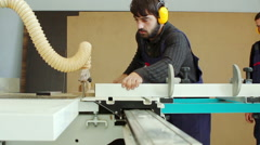 Carpenter cutting wooden plank Stock Footage