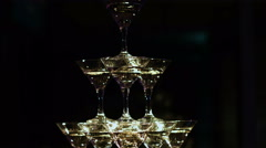 Martini glasses in the form of a cascade or pyramid at wedding party Stock Footage