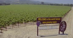 Aerial drone view of Napa Valley welcome sign and vineyards Stock Footage