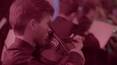 The violinist plays the violin in the orchestra Stock Footage