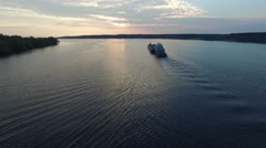 Cargo vessel floating in the river at dawn. Aerial view. Stock Footage