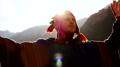 Young shaman man doing mediation recreation activity outdoors at sunset sky Stock Footage