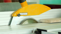 Electric buzz saw cutting some wood boards Stock Footage