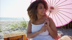 Portrait of plus size Ethnic African American female with a parasol at the beach Stock Footage