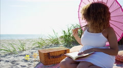 Portrait of voluptuous African American female with a book on literature reading Stock Footage