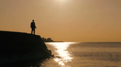 Silhouette of man. person people. male. leisure activity. recreational. sunset Stock Footage
