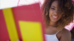 Afro hair Ethnic African American female enjoying summer reading a book Stock Footage