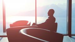 Businessman. modern luxury interior. man male. person sitting. sunset silhouette Stock Footage