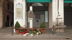 Memorial plaque of Piazza della Loggia bombing and flowers in Brescia Stock Footage