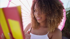 Afro hair African American female carefree and happy on the beach  Stock Footage