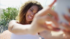 Relaxed and happy afro hair Ethnic African American female using camera  Stock Footage