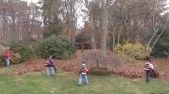 Landscapers use Leaf Blowers on LI Stock Footage