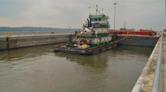 River Barge Passes Through Dam Locks Stock Footage