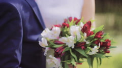 Bridal Red & White Bouquet in Hands of Newlywed Stock Footage
