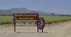 Aerial drone view of Napa Valley welcome sign and vineyards - stock footage