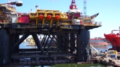 Floating production facility (oil rig platform) during renovation at shipyard - stock footage