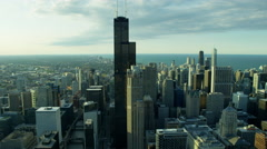 Aerial view of Lake Michigan behind city skyscrapers of Chicago Stock Footage