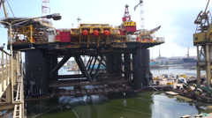 Floating production facility (oil rig platform) during renovation at shipyard Stock Footage