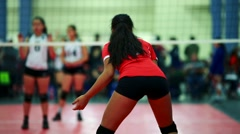 Teenage girls playing indoor volleyball game Stock Footage