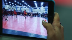 Cool shot of Volleyball game being recorded through a tablet computer - stock footage