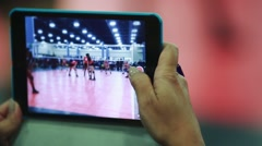 Close up of female recording volleyball game through tablet computer Stock Footage