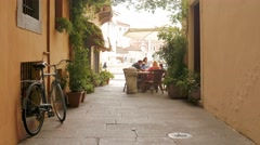Brescia – Italy: People eating in a typical alley in Italy Stock Footage