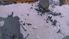 Aerial view excavator scoop loads a dump truck. Stock Footage