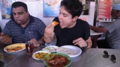 People Eating Lunch in Singapore's Little India Stock Footage