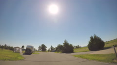 Car driving through campground with motorhomes at Chatfield State Park.-POV poin Stock Footage