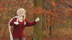 Fashion woman in windy fall autumn park forest. - stock photo
