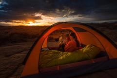 Cup of Coffe at Sunrise Reflection Canyon Utah Lake Powell Camping - stock photo