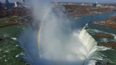 Powerful waterfalls seen from above with rainbow and mist - stock footage