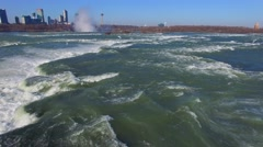 Pan-up and rotating shot of birds over the river in Niagara Falls Stock Footage