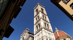 Florence Duomo, tilt down from dome to people in the plaza. Stock Footage