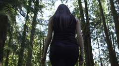 A girl walking in the forest Stock Footage