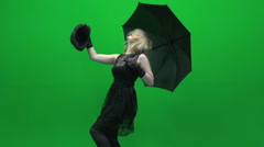 Women dancing with black umbrella isolated green screen Stock Footage