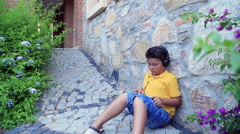 Young boy with  earphone using digital tablet Stock Footage