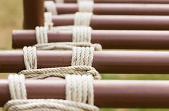 Rope knot around metal pipe Stock Photos