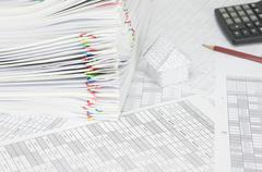 Pile paperwork of report with colorful paperclip on finance account - stock photo
