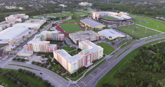 Aerial of Buildings & Track Field at the University Of Central Florida Stock Footage