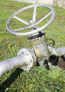 Big gate valve for closing or opening the pipeline Stock Photos