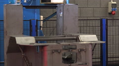 steel plant metal and iron a robotic welding arm starts welding - stock footage