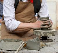 Skilled craftsman potter shaping clay to make a beautiful vase handmade Stock Photos