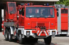 Big red truck fire engines in the fire department station Kuvituskuvat
