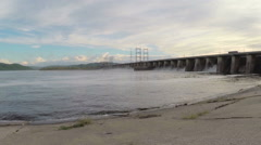 Young woman and two children look at hydroelectric power station. Slow motion Stock Footage
