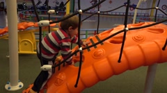Child climbs up with all his strength Stock Footage