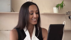 Woman using app on touch screen tablet for video call - stock footage
