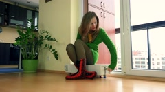 Young Frozen Woman Adjusting Thermostat On Radiator At Home - stock footage