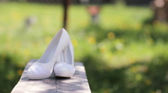 Wedding shoes on grass background - stock footage