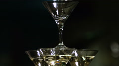 Martini glasses in the form of a cascade or pyramid lit light at the party Stock Footage